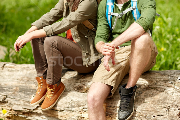 close up of couple resting on tree trunk outdoors Stock photo © dolgachov