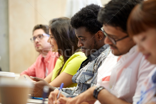 group of international students writing at lecture Stock photo © dolgachov