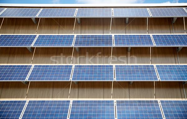 Solar bateria edifício fachada energia poder Foto stock © dolgachov