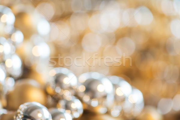christmas balls decoration or beads bokeh Stock photo © dolgachov