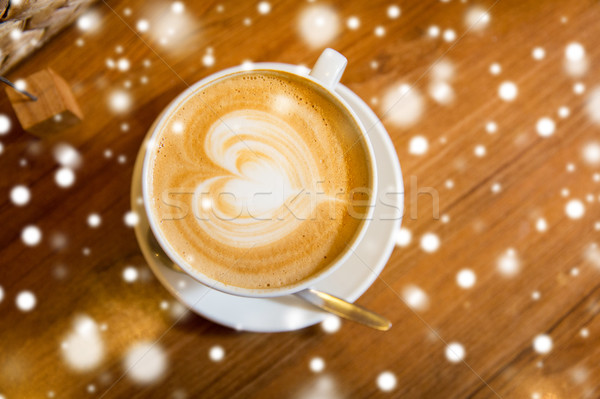 close up of coffee cup with heart shape drawing Stock photo © dolgachov