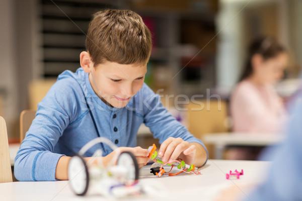 close up of boy building robot at robotics school Stock photo © dolgachov