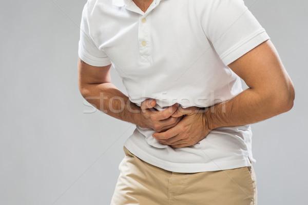 Mann Leiden Magenschmerzen Menschen Gesundheitswesen Stock foto © dolgachov