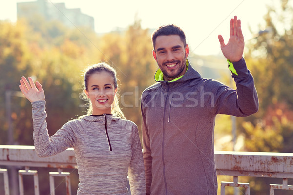 Souriant couple main extérieur fitness Photo stock © dolgachov