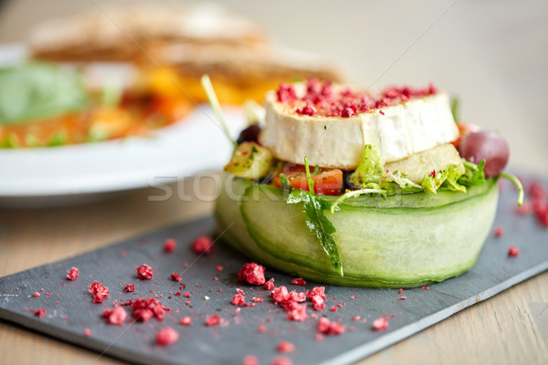 goat cheese salad with vegetables at restaurant Stock photo © dolgachov