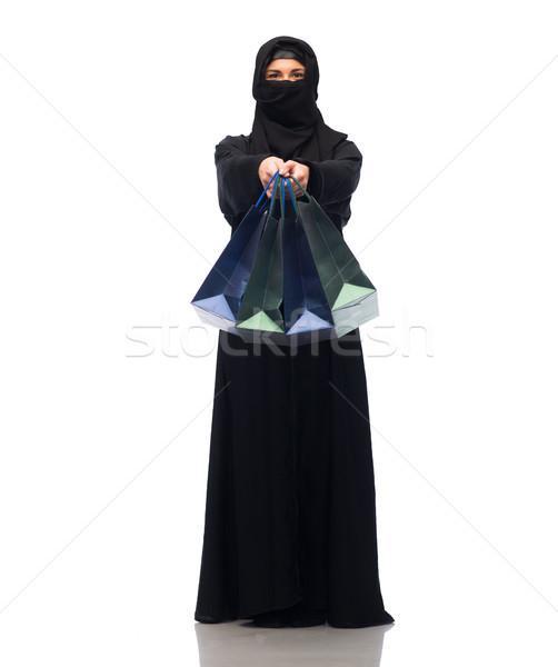muslim woman in hijab with shopping bags Stock photo © dolgachov