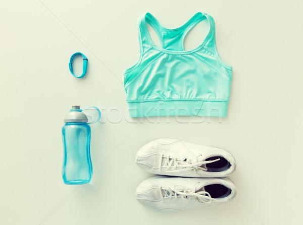 close up of sportswear, bracelet and bottle Stock photo © dolgachov