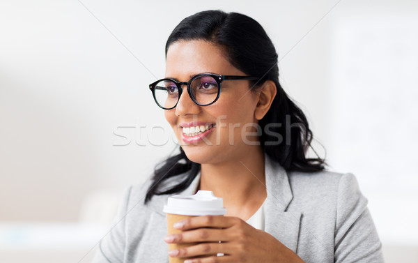 businesswoman with coffee in paper cup at office Stock photo © dolgachov