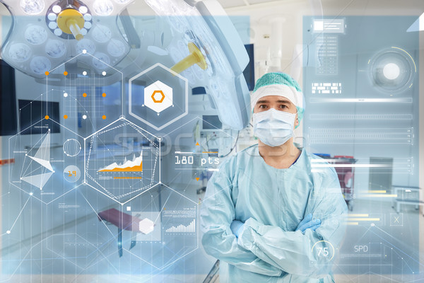 surgeon in operating room at hospital with charts Stock photo © dolgachov