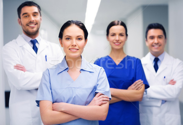 happy group of medics or doctors at hospital Stock photo © dolgachov