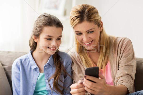 happy family with smartphone at home Stock photo © dolgachov