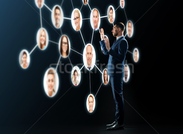 buisnessman looking at contacts network Stock photo © dolgachov