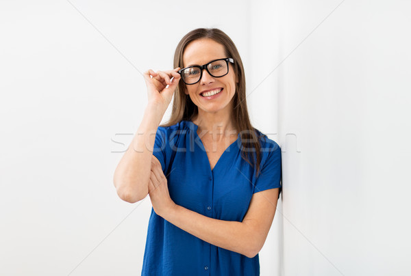 happy smiling middle aged woman in glasses Stock photo © dolgachov