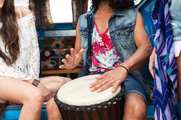 Hippie amigos jugando tambor verano Foto stock © dolgachov