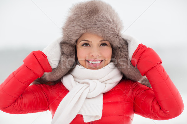 happy smiling woman in winter fur hat outdoors Stock photo © dolgachov