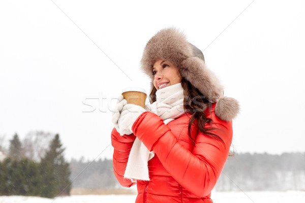 happy woman in winter fur hat with coffee outdoors Stock photo © dolgachov