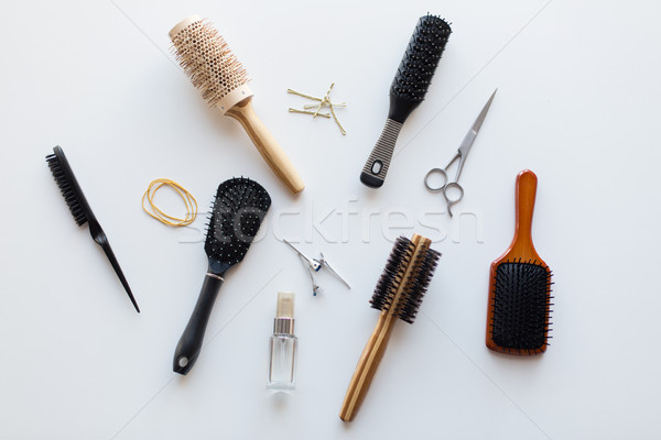 scissors, hair brushes, clips and styling spray Stock photo © dolgachov