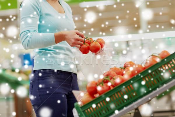 Client sac achat tomates épicerie vente Photo stock © dolgachov