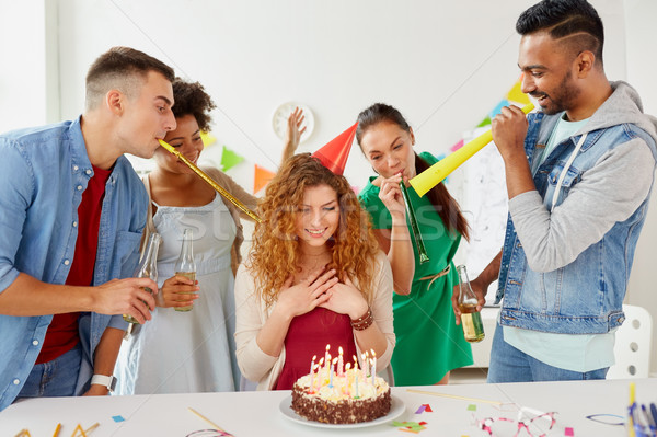 Stock photo: happy coworkers with cake at office birthday party