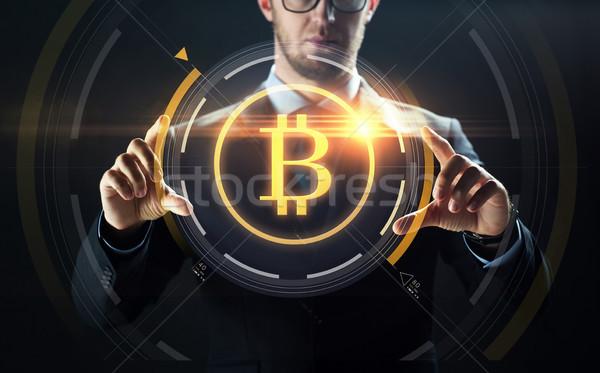 Empresário bitcoin holograma financiar negócio Foto stock © dolgachov