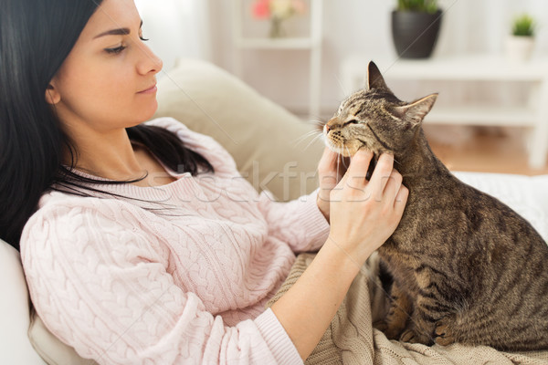 close up of woman with tabby cat in bed at home Stock photo © dolgachov