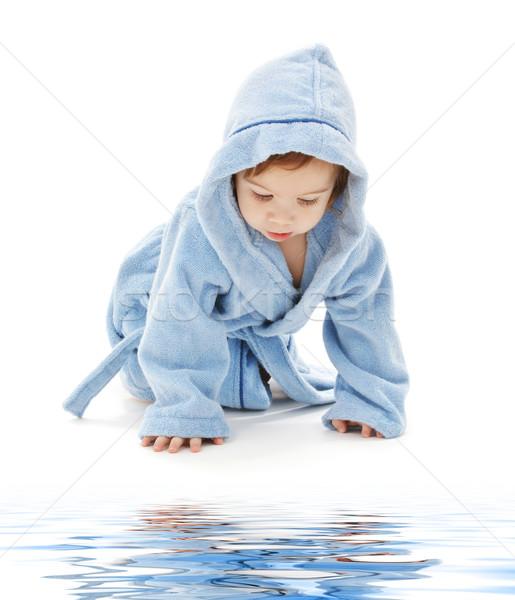 Baba fiú kék köntös fehér víz Stock fotó © dolgachov