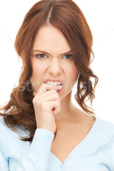 Donna mordere dito primo piano ritratto foto Foto d'archivio © dolgachov