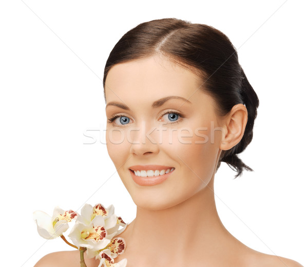 Stock photo: lovely woman with orchid flower