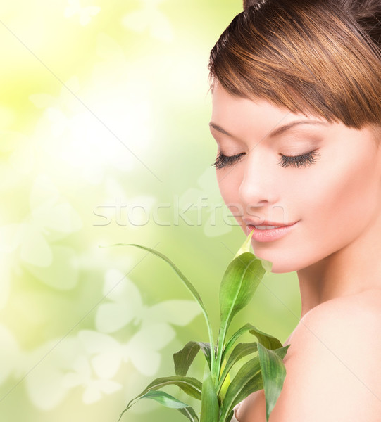 woman with sprout and butterflies Stock photo © dolgachov