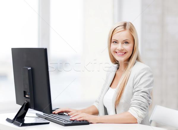 Сток-фото: деловая · женщина · компьютер · фотография · улыбаясь · бизнеса