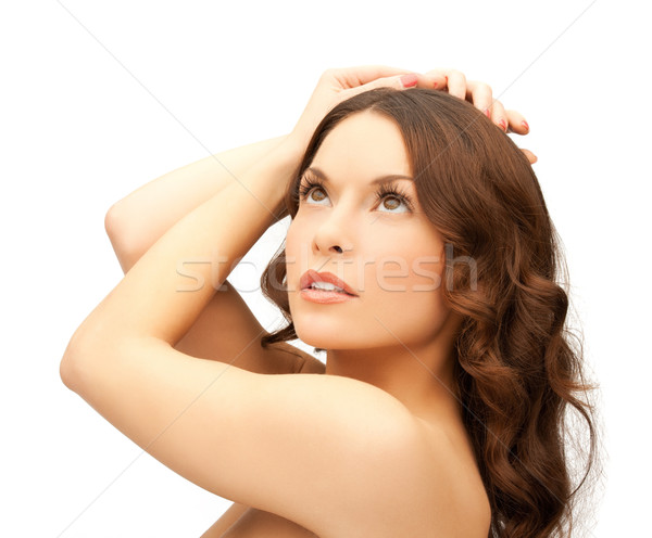 woman with curly hair Stock photo © dolgachov
