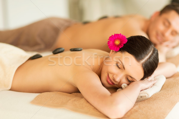 couple in spa with hot stones Stock photo © dolgachov