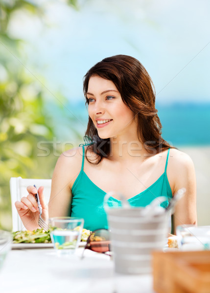 girl eating in cafe on the beach Stock photo © dolgachov