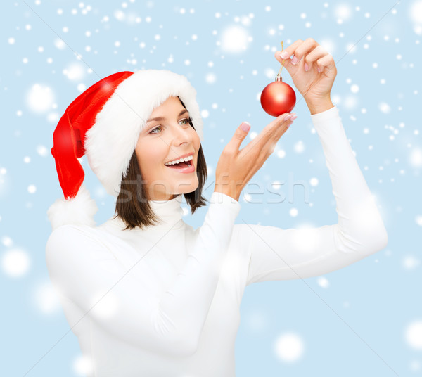 woman in santa helper hat with christmas ball Stock photo © dolgachov