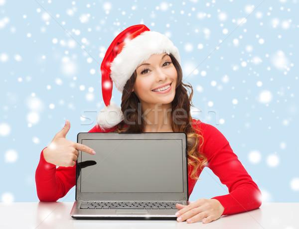 Nő mikulás segítő kalap laptop számítógép karácsony Stock fotó © dolgachov