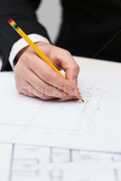 male contractor making changes to blueprint Stock photo © dolgachov