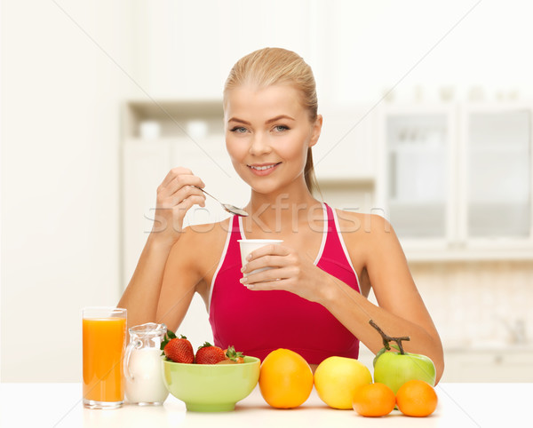 young woman eating healthy breakfast Stock photo © dolgachov