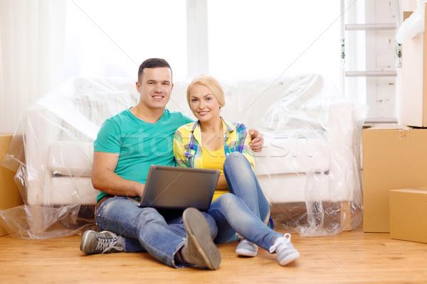 Pár laptop ül padló új ház mozog Stock fotó © dolgachov