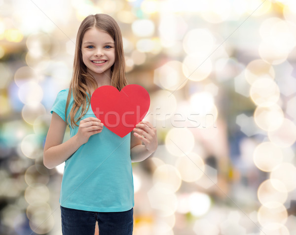 smiling little girl with red heart Stock photo © dolgachov