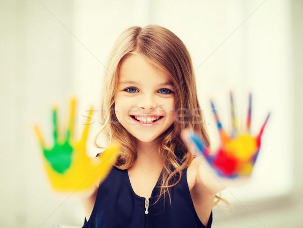 Mosolyog lány mutat festett kezek oktatás Stock fotó © dolgachov
