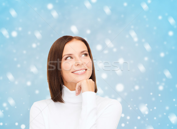 4828401_stock-photo-thinking-and-smiling-woman-in-white-sweater.jpg