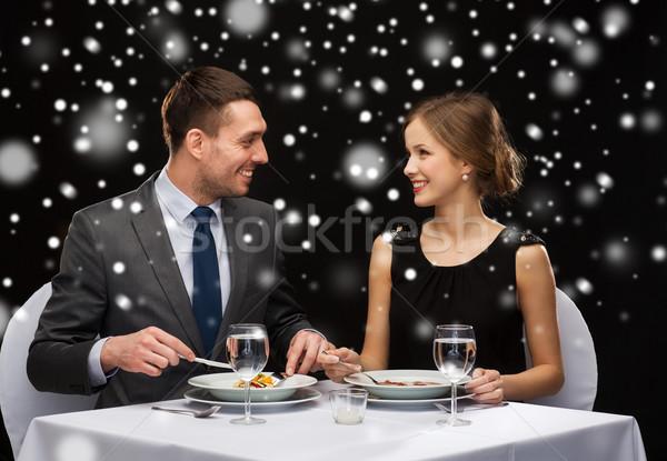 Gülen çift yeme Noel Stok fotoğraf © dolgachov