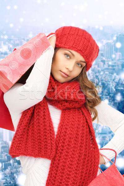 Stock photo: smiling young woman with shopping bags