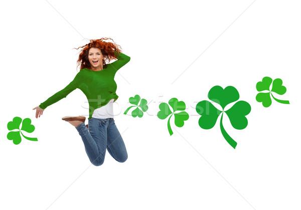 Sorridente saltando ar shamrock movimento Foto stock © dolgachov