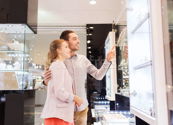 couple looking to shopping window at jewelry store Stock photo © dolgachov