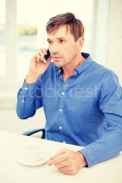Teléfono celular taza café negocios comunicación moderna Foto stock © dolgachov