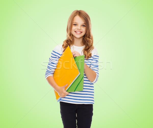 Stock fotó: Boldog · lány · tart · színes · mappák · oktatás · emberek