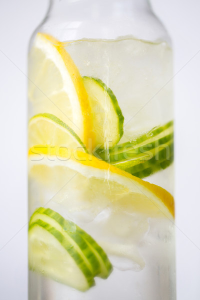 close up of fruit water in glass bottle Stock photo © dolgachov