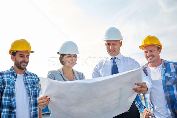 Groupe constructeurs plan affaires bâtiment travail d'équipe Photo stock © dolgachov