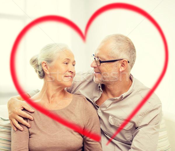 Feliz casal de idosos sofá casa família Foto stock © dolgachov